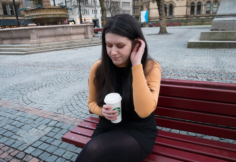 Jess Wilby sat outside Manchester town hall speaking about what if syndrome.