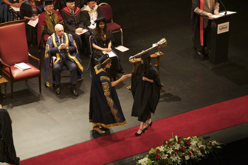 Me accepting my degree on graduation day!