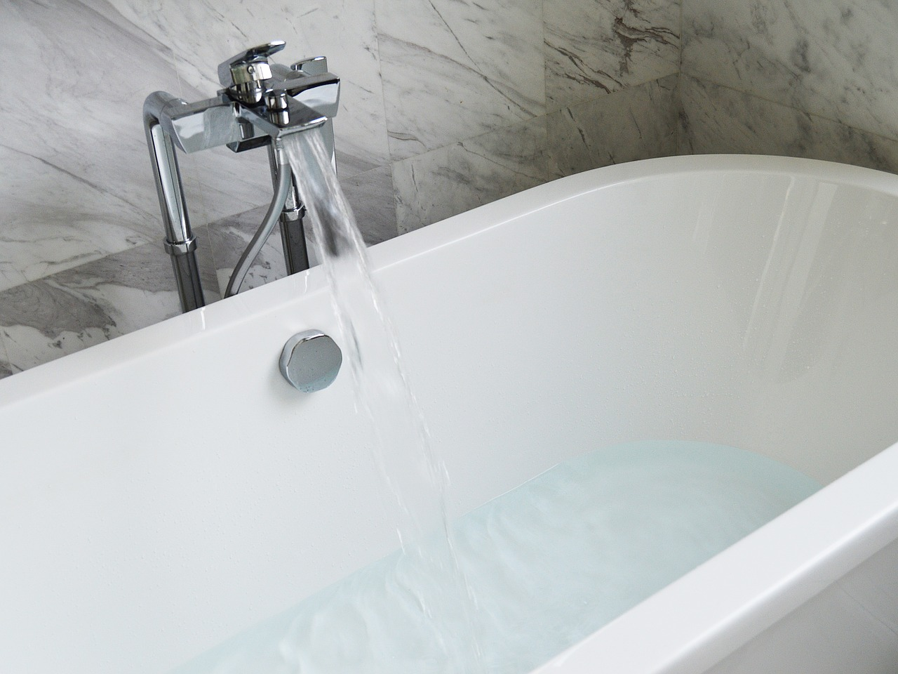 Luxury bathtub with running water