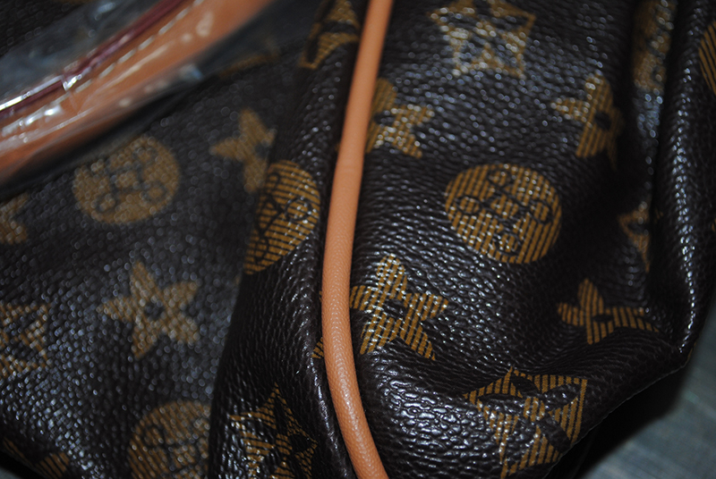 Fake louis vutton designer handbag up close that was seized by the UK home office and Border Force.