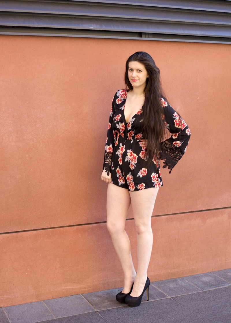 Ark playsuit covered in red flowers.